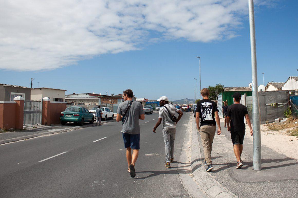 Chris and two others with Siya on a Khayelitsha walking tour.