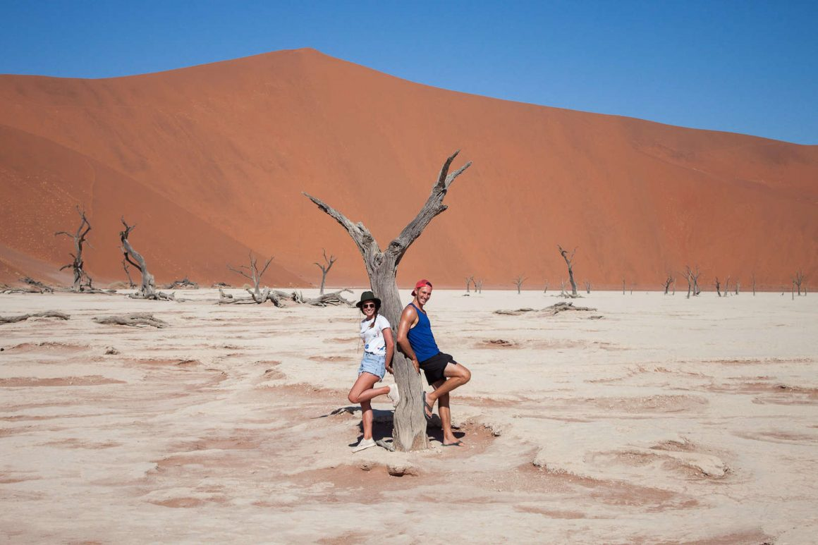 Kim and Chris lean on a tree in Dead Vlei Namibia