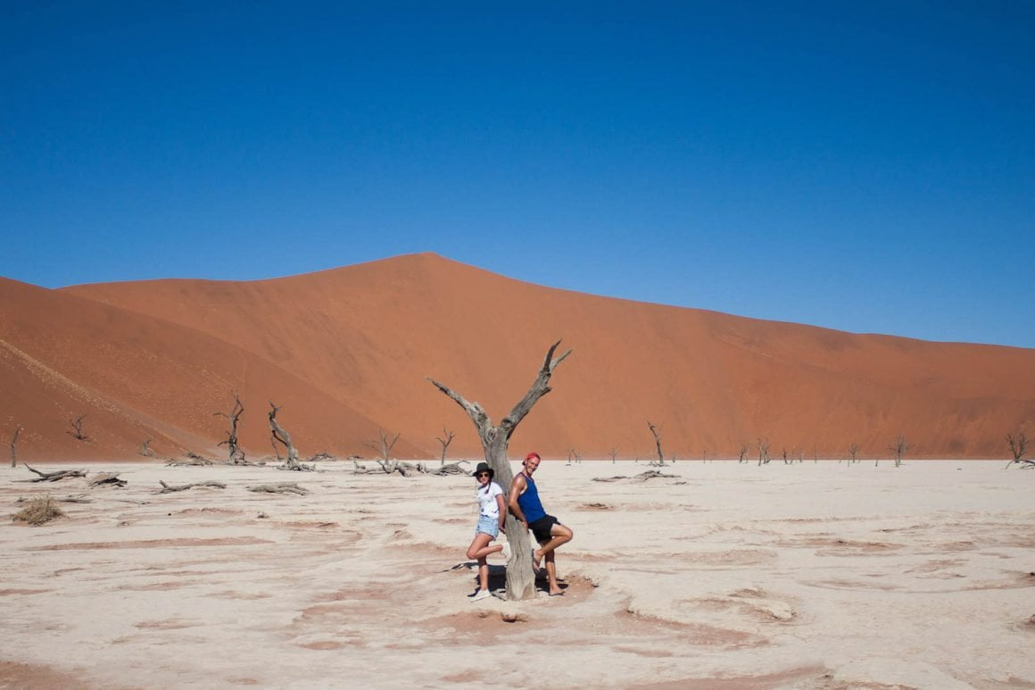 Kim and Chris leaning against a tree in Dead Vlei in Sossusvlei