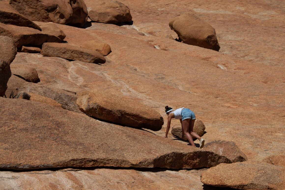 Kim climbs up the unique rock formations in Spitzkoppe