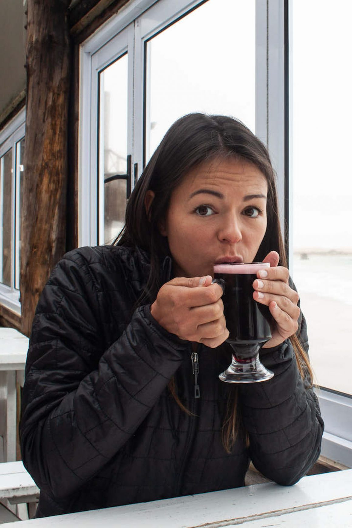 Kim warming up with her puffy down jacket drinking Gluwein in Swakopmund, Namibia.