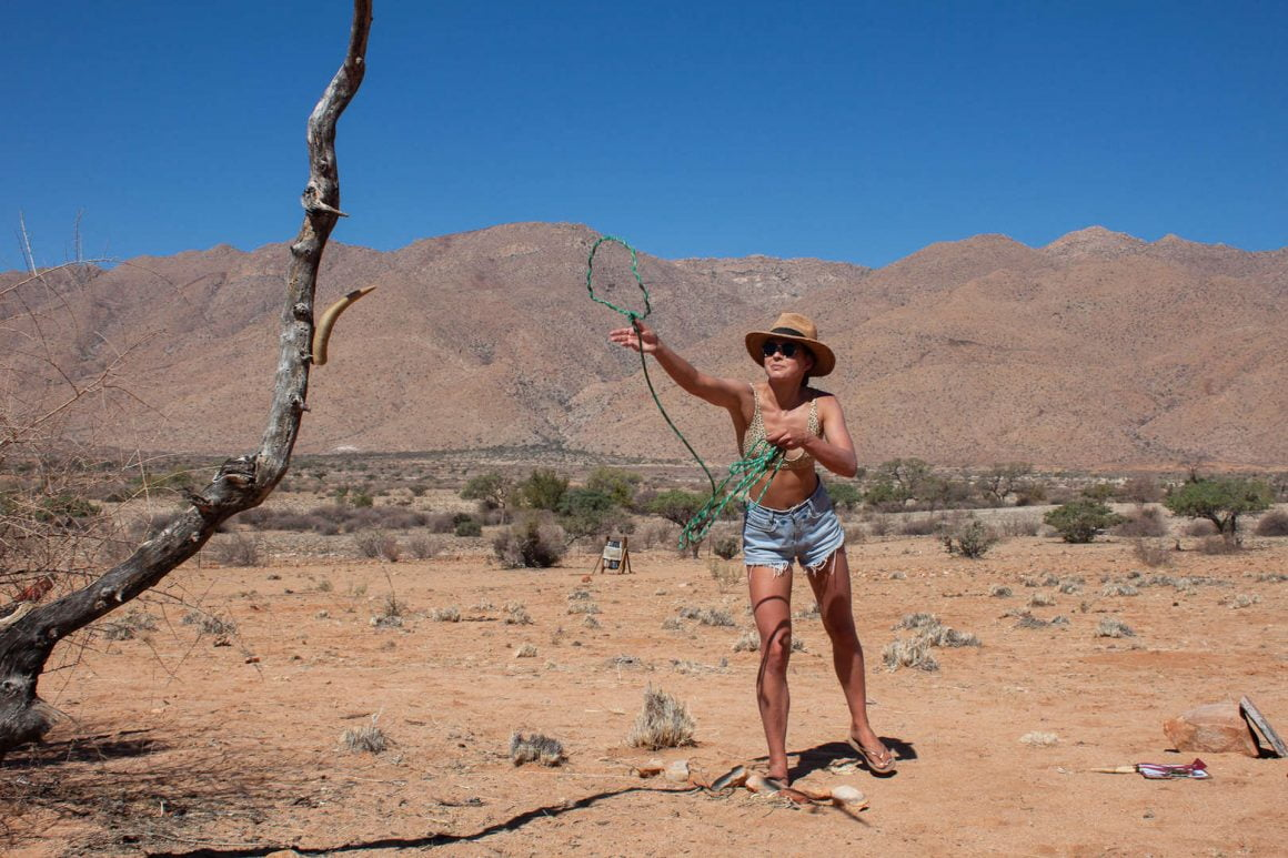 Kim trying to lasso a tree as part of the Adventure Trail, an interactive game the owners of Gecko Camp in Namibia organized for their guests.
