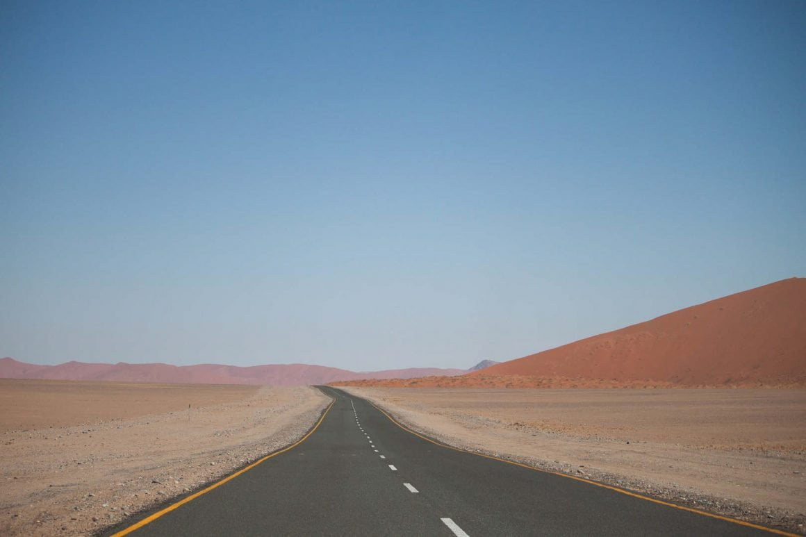 Driving on the paved road towards Dead Vlei in Sosssuvei