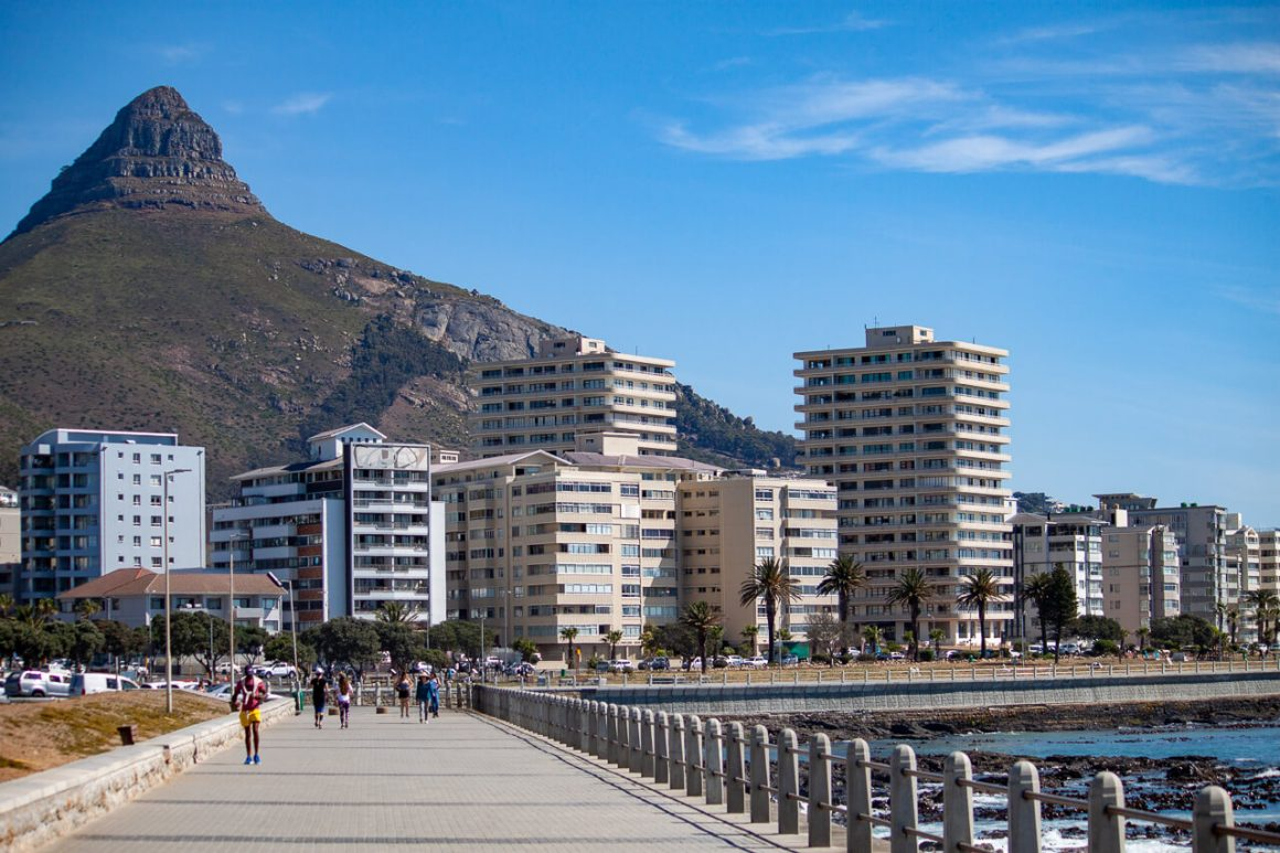 The Sea Point Promenade with Lion's Head behind.