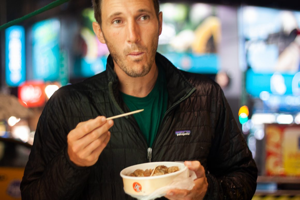Chris eats grilled King Oyster mushrooms from the night market
