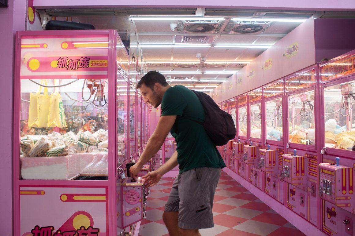 chris-playing-arcade-game-taipei