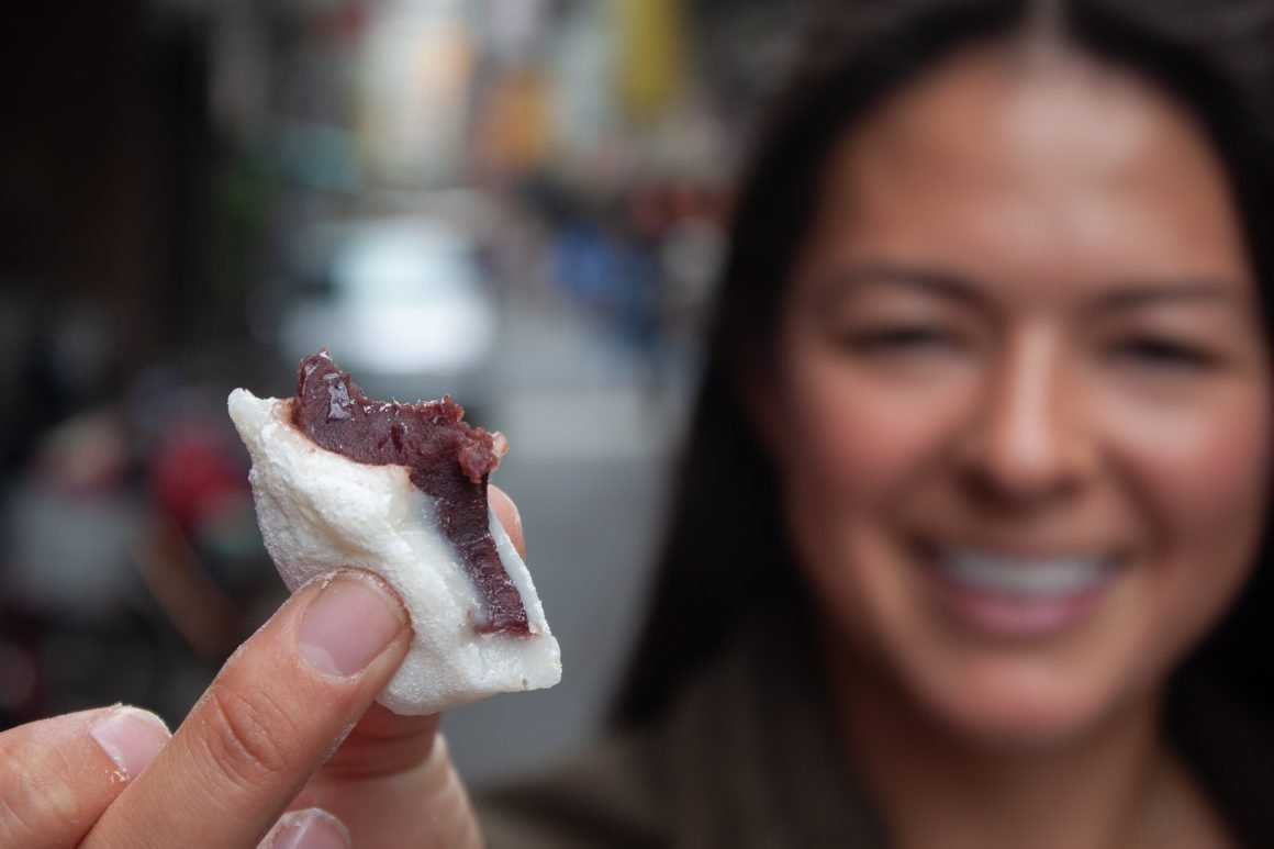 Kim showing us her delicious red bean mochi on a day in Taipei Layover