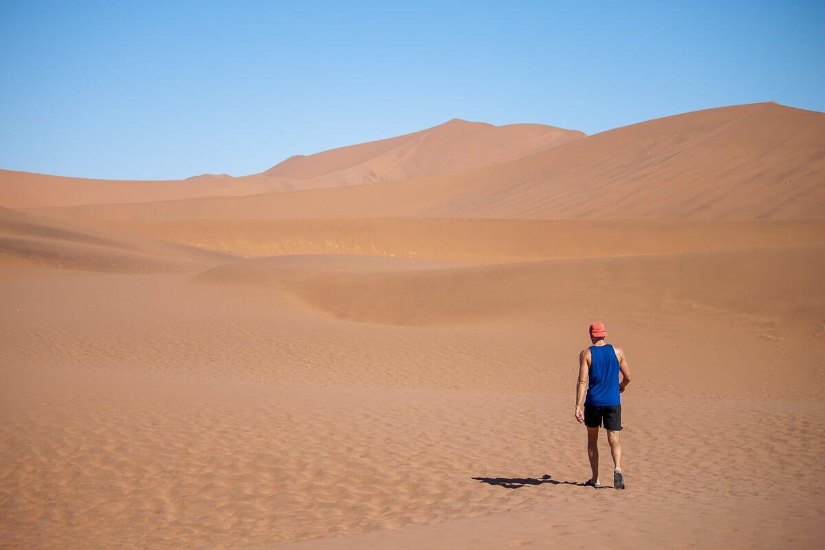 Chris walking in his Icebreaker tank top in the Namibian desert at Sossusvlei