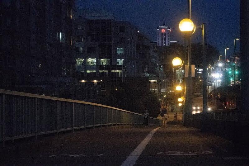 Walking along a Vancouver bridge at night