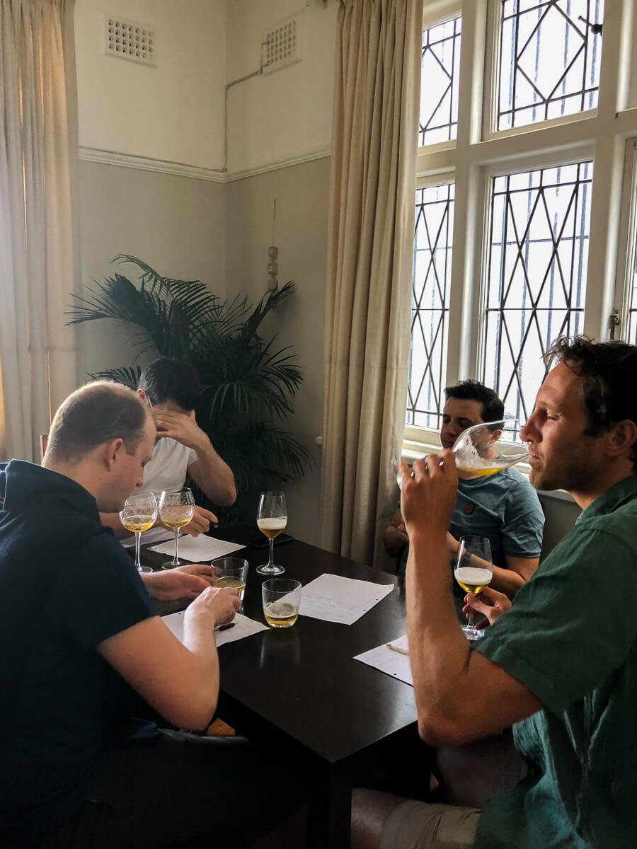 Chris and new friends doing a beer blind taste test in Cape Town.