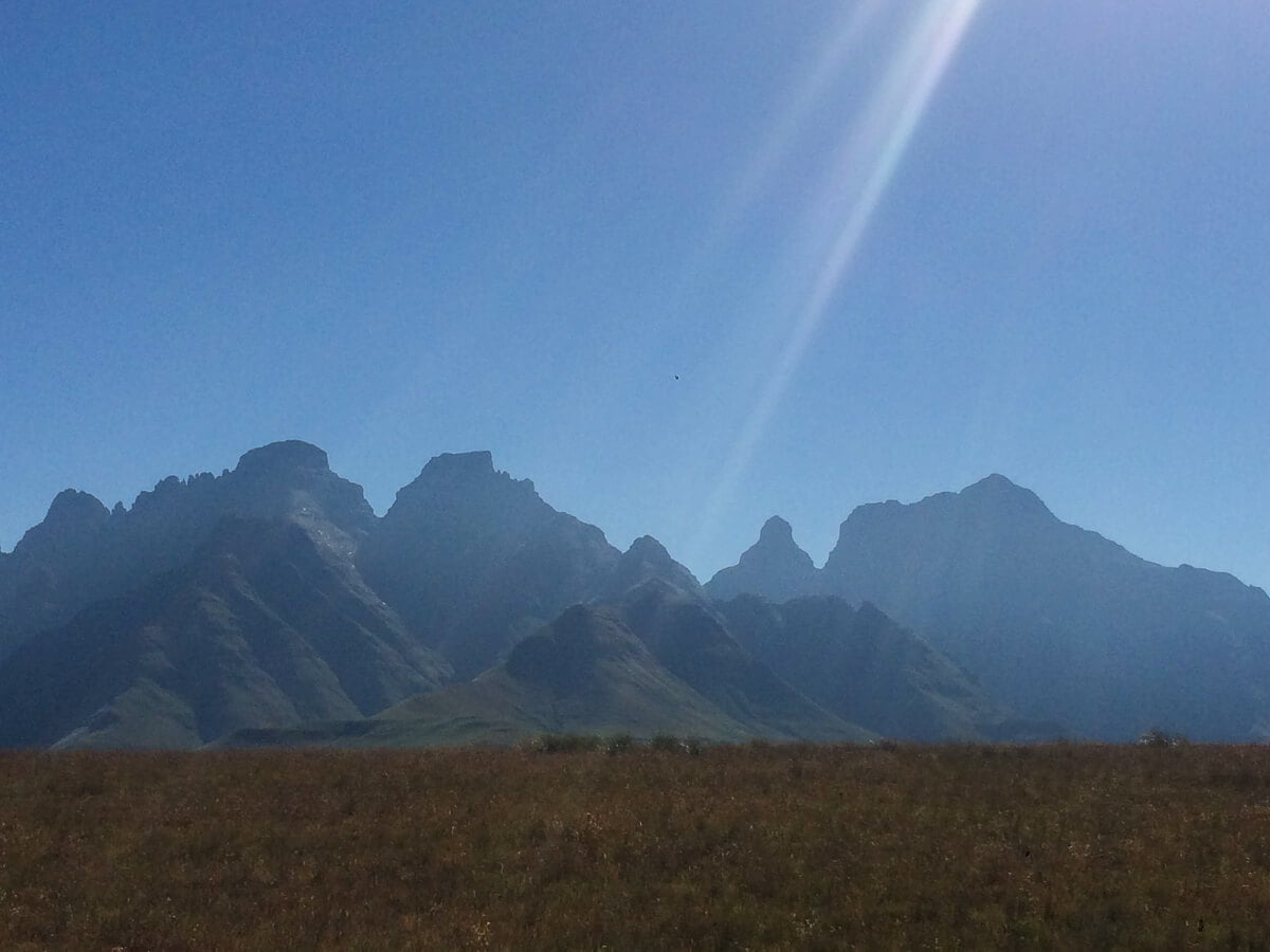 Cathedral Peak in the distance while hiking in Drakensberg.