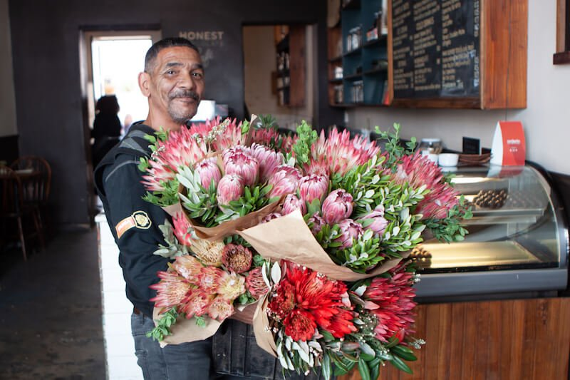 Guy selling fynbos flowers
