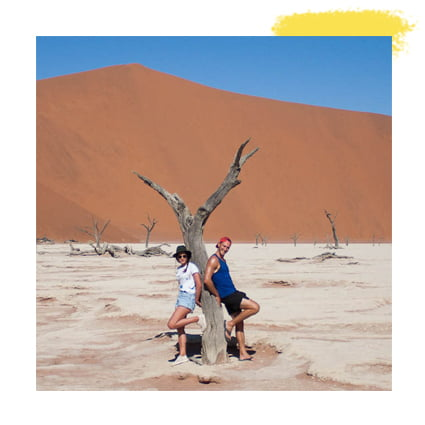 Kim and Chris lean up against a tree in Deadvlei, Namibia.
