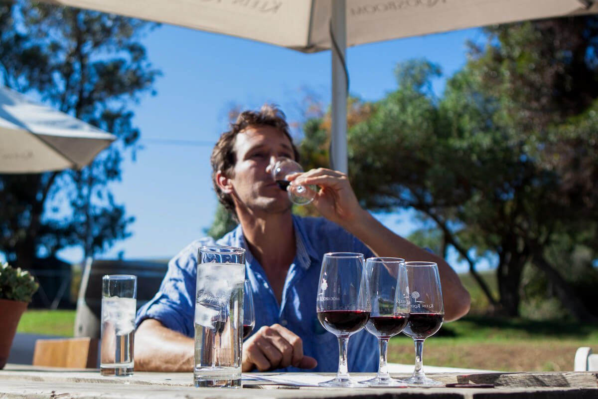Chris sipping wine at one of the many wineries just outside of Cape Town in the Western Cape