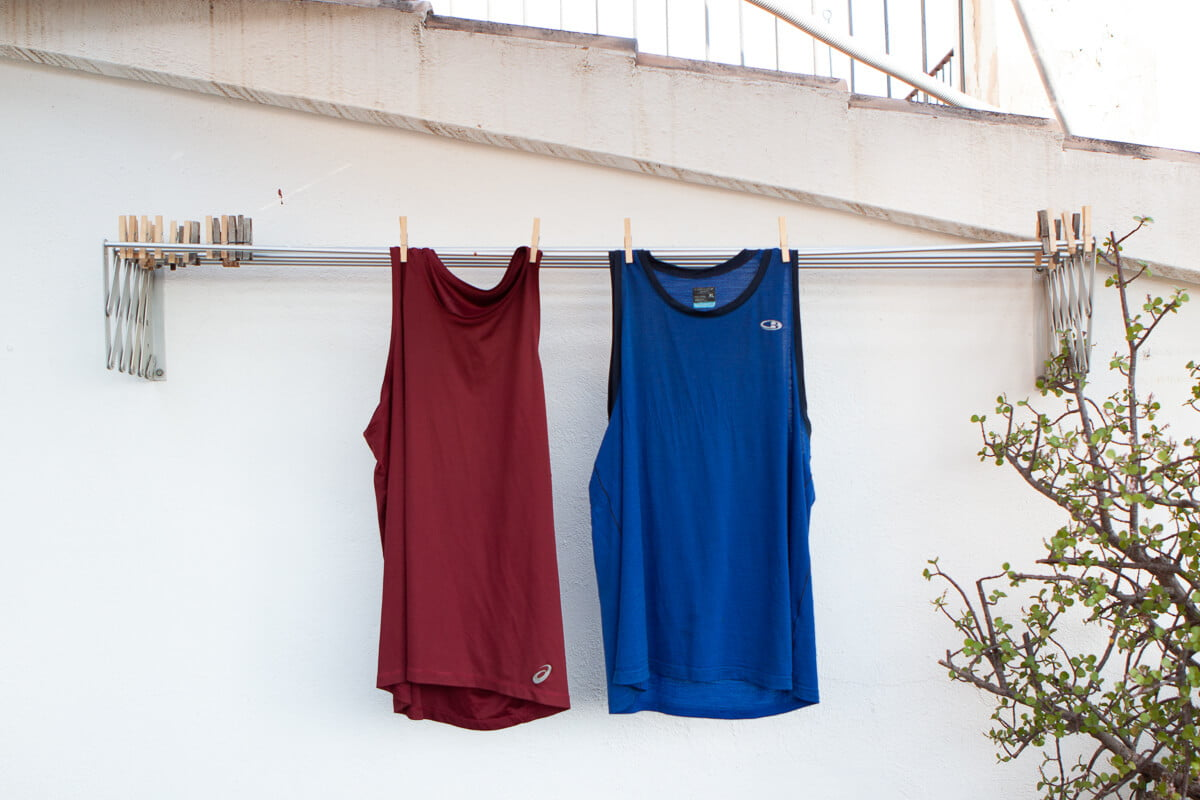 Merino wool and synthetic shirts hanging side-by-side
