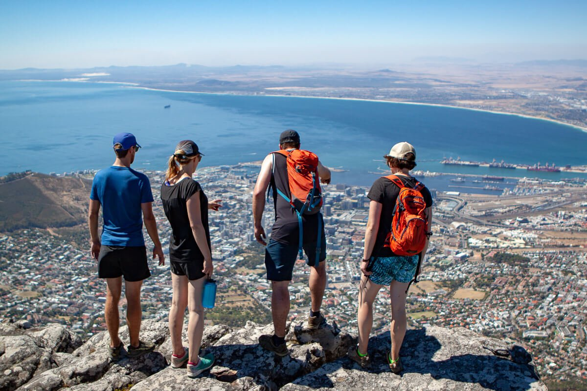 Cape Town destination guide cover image of our friends looking down on the city from atop Table Mountain