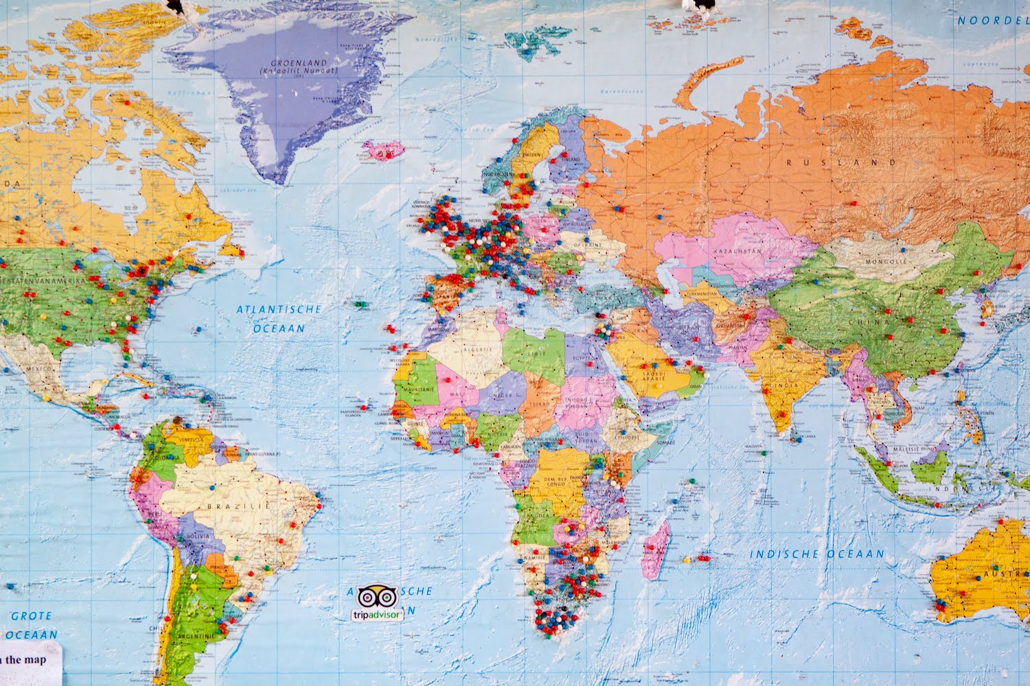 How many countries have you been to cover image of world map with pins.