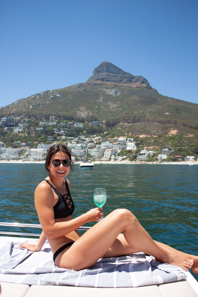 Kim in a bikini sipping wine on a boat in Cape Town.