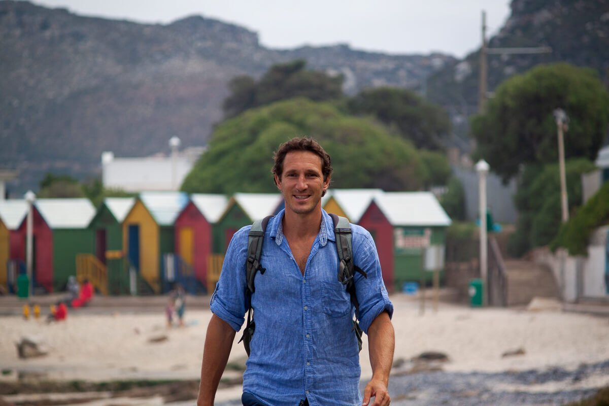 Cover image for move to a new city post - Chris walking along the beach path in Muizenberg just outside of Cape Town