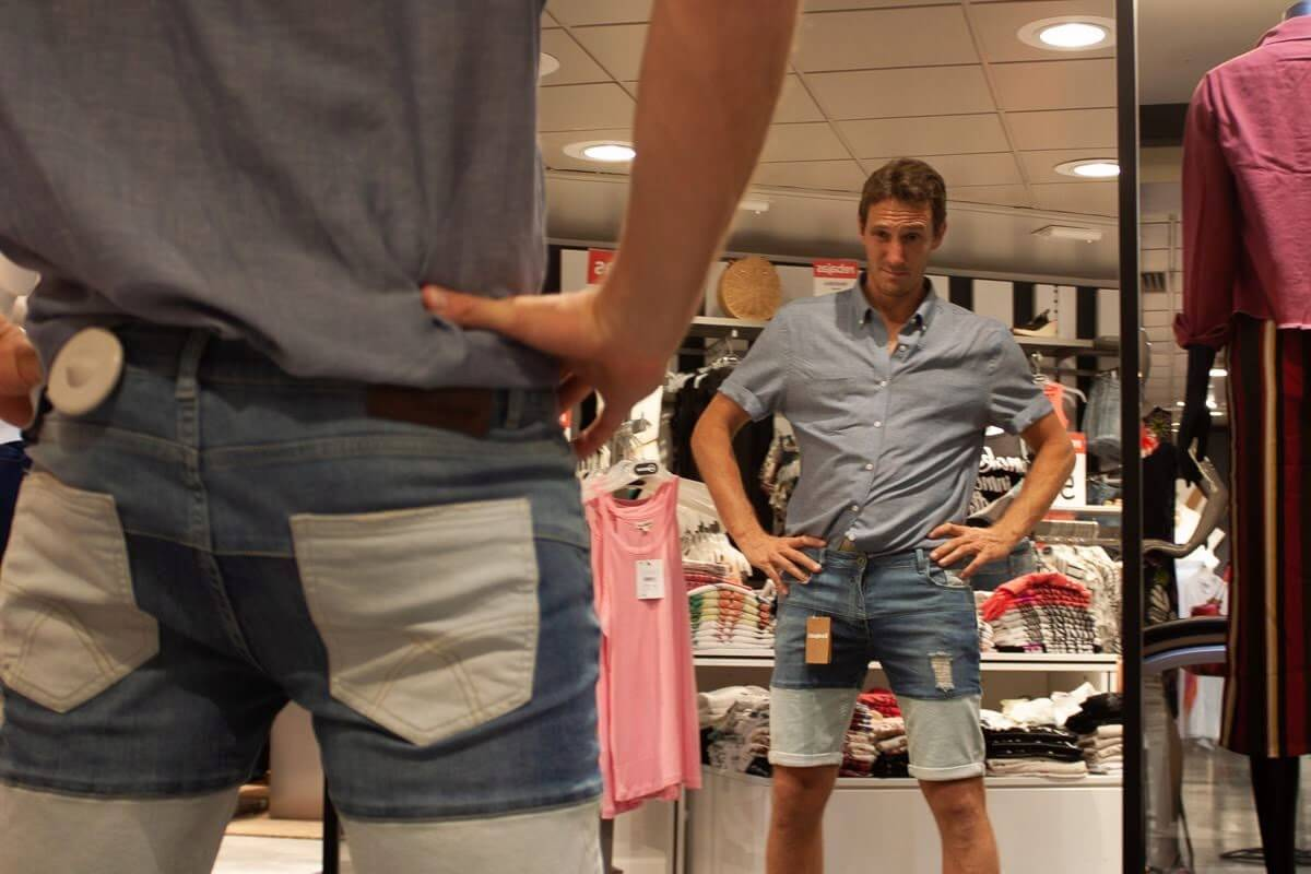 Trying on ugly shorts and looking in the mirror