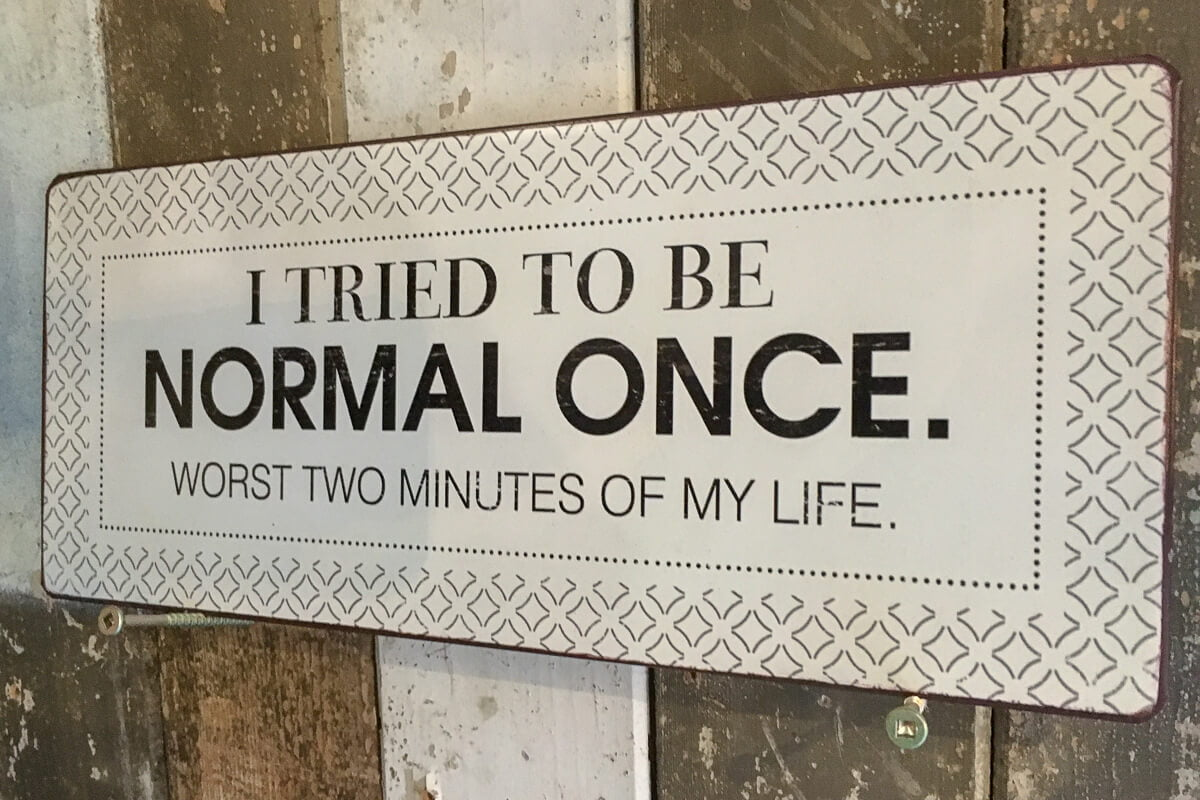 "Unconventional ideas cover of a sign saying ""I tried to be normal once. Worst two minutes of my life."""
