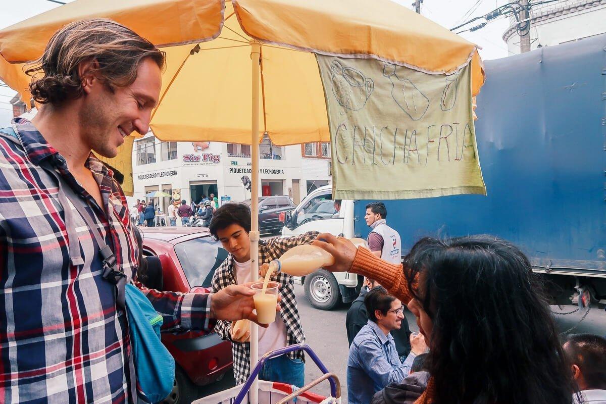 Street vendor pours Chris some chicha in Mexico City - Alr