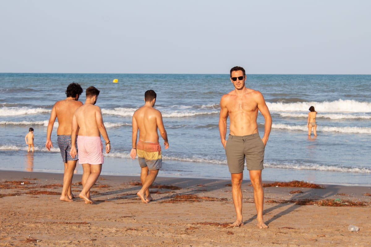 Chris wearing his outlier shorts on the beach in Valencia
