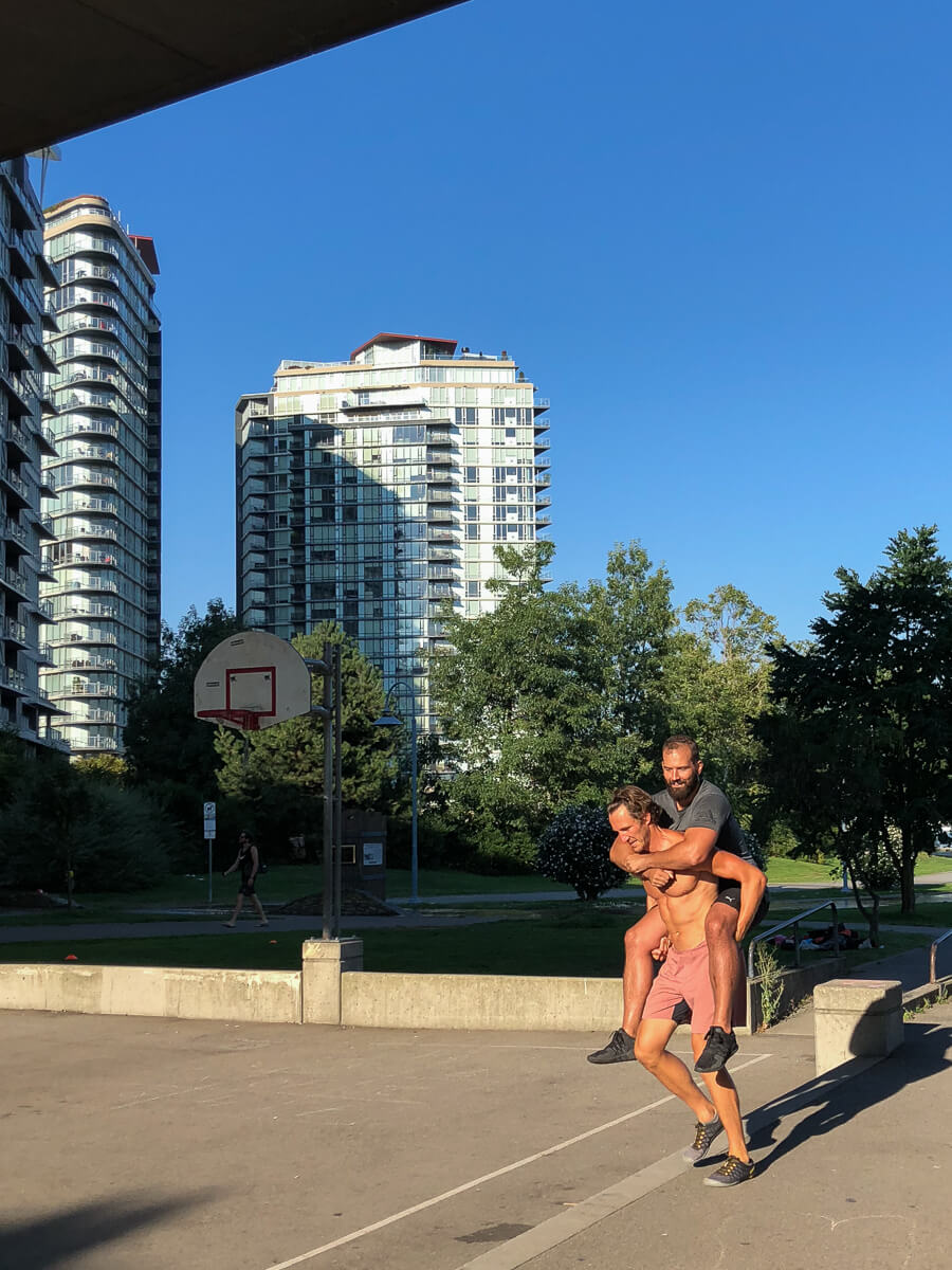 Piggy back working out outdoors in Vancouver
