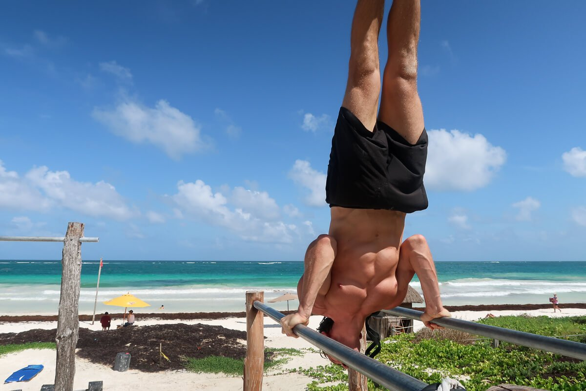 Chris doing a shoulder stand in Tulum, Mexico.
