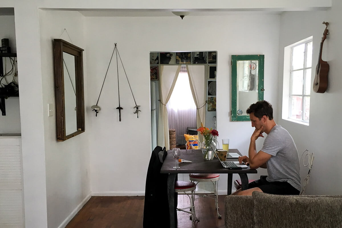 Chris working at a table in Airbnb