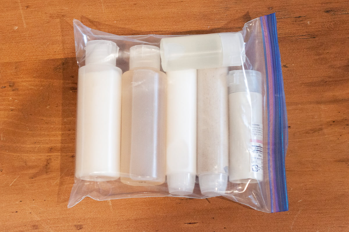 Muji containers in a ziploc bag, ready for travel.