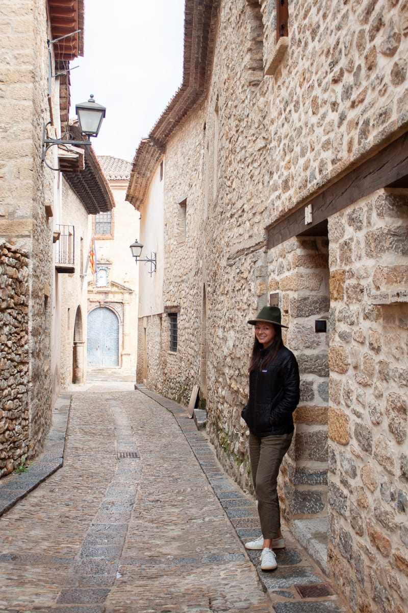 Kim wearing her Patagonia Nano puff jacket visiting one of Spain's most beautiful towns