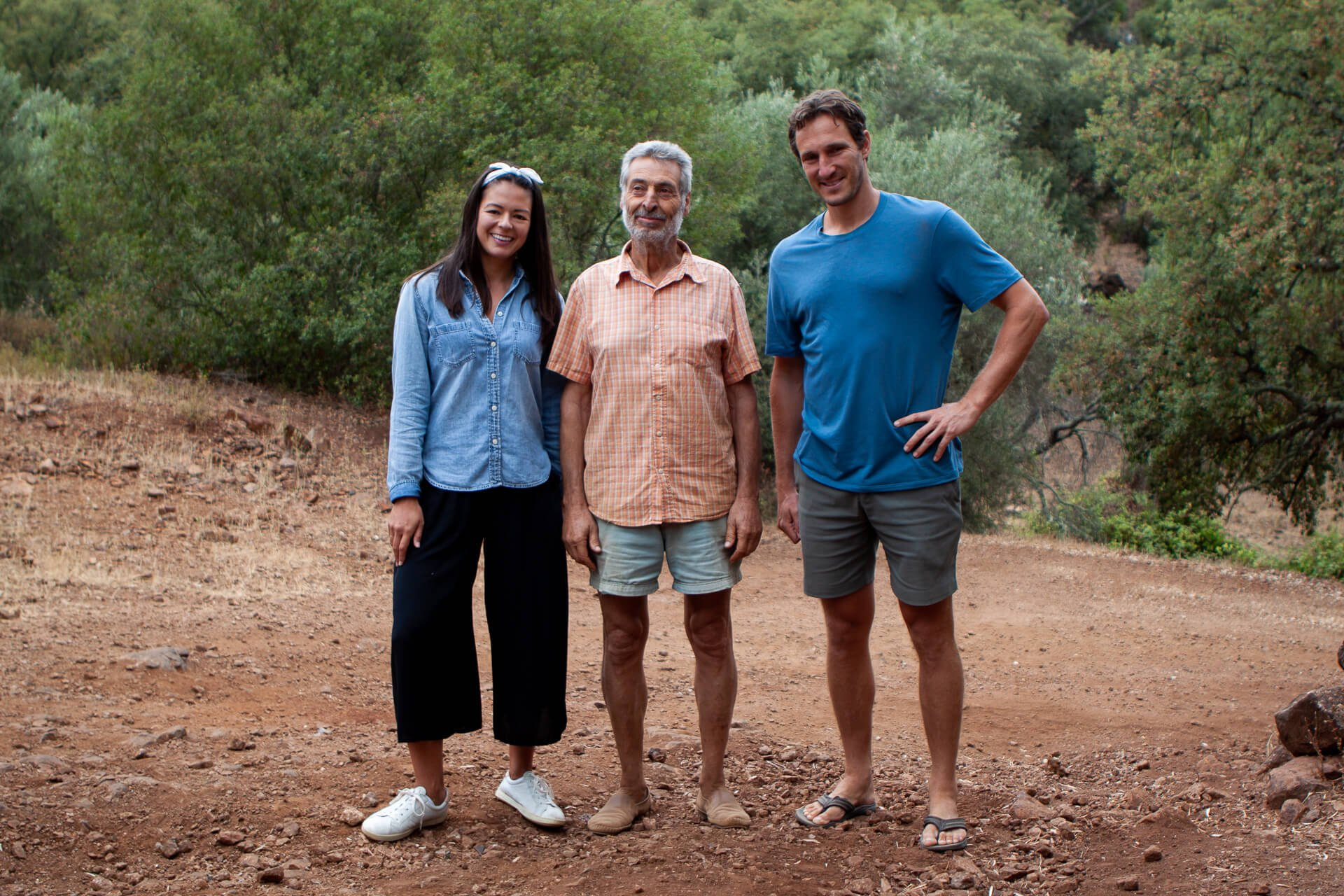 Kim, Eduardo, and Chris pose after learning from the pig farmer that sells the most expensive Jamon Iberico.