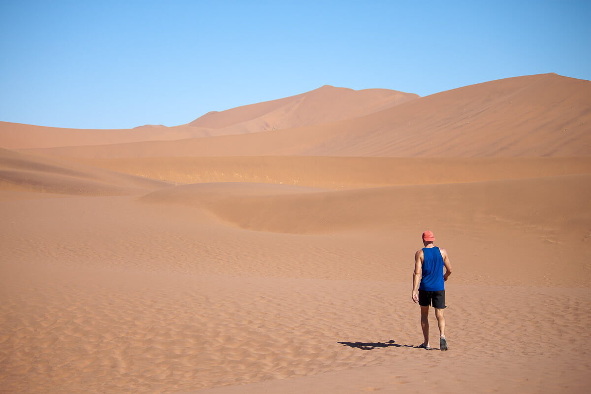 Chris walking alone in the desert