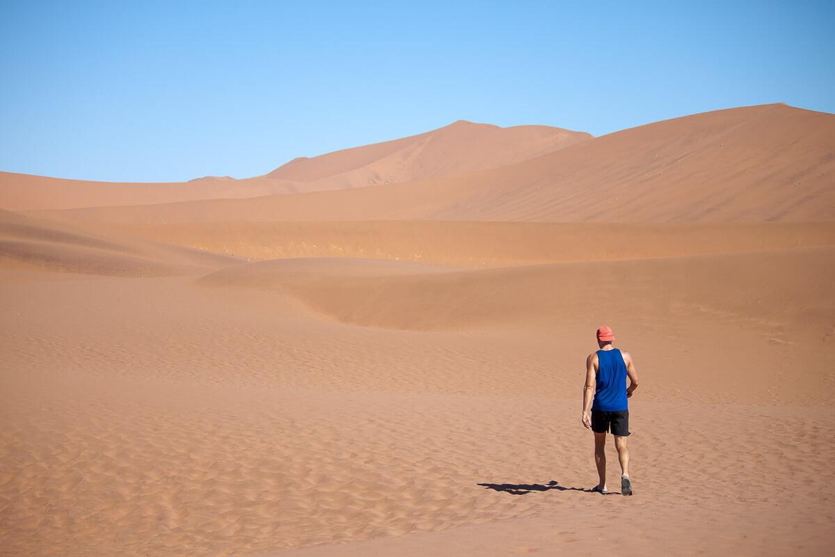 Chris walking alone in the desert