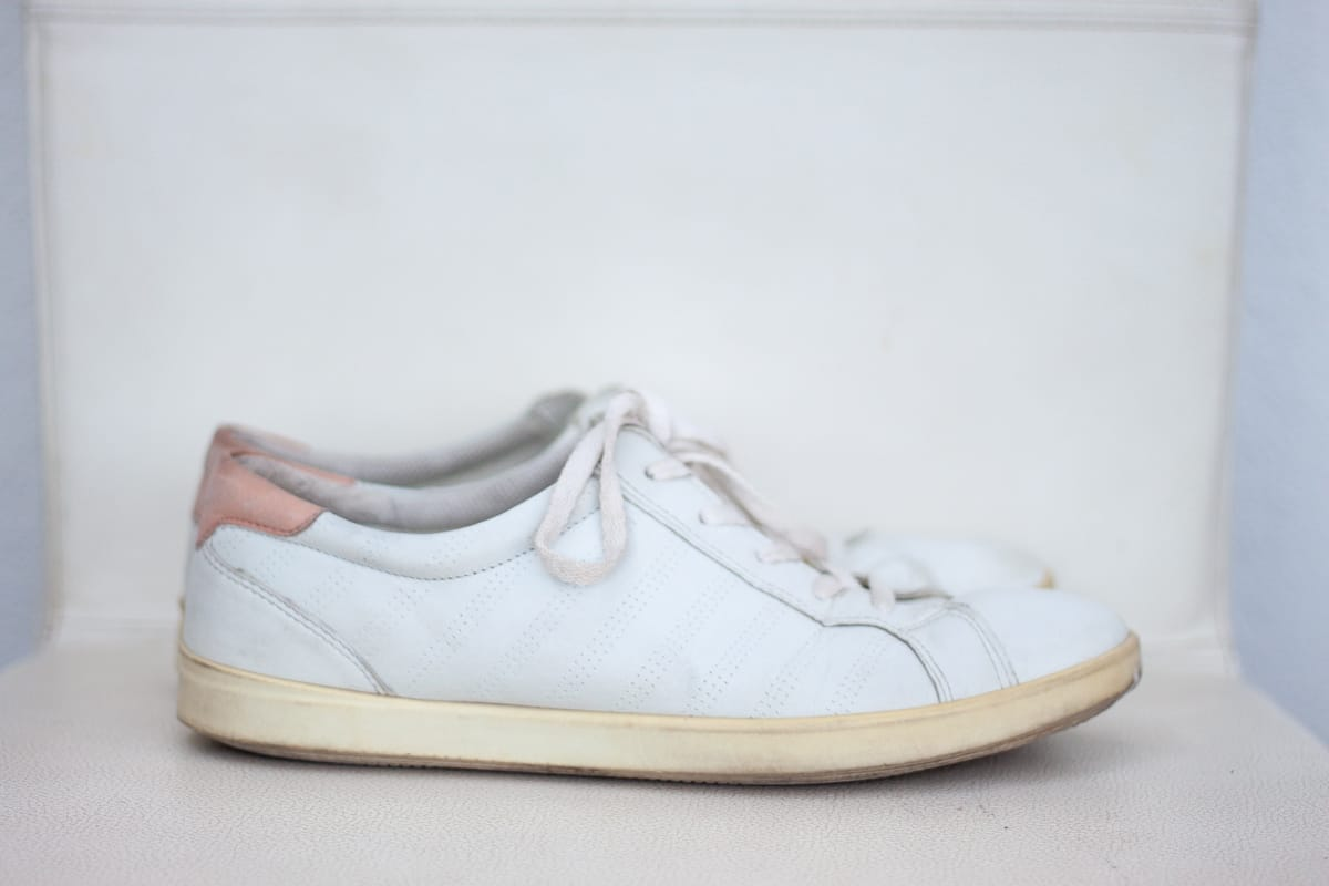 Ecco White Sneakers are one of my travel essentials for women.