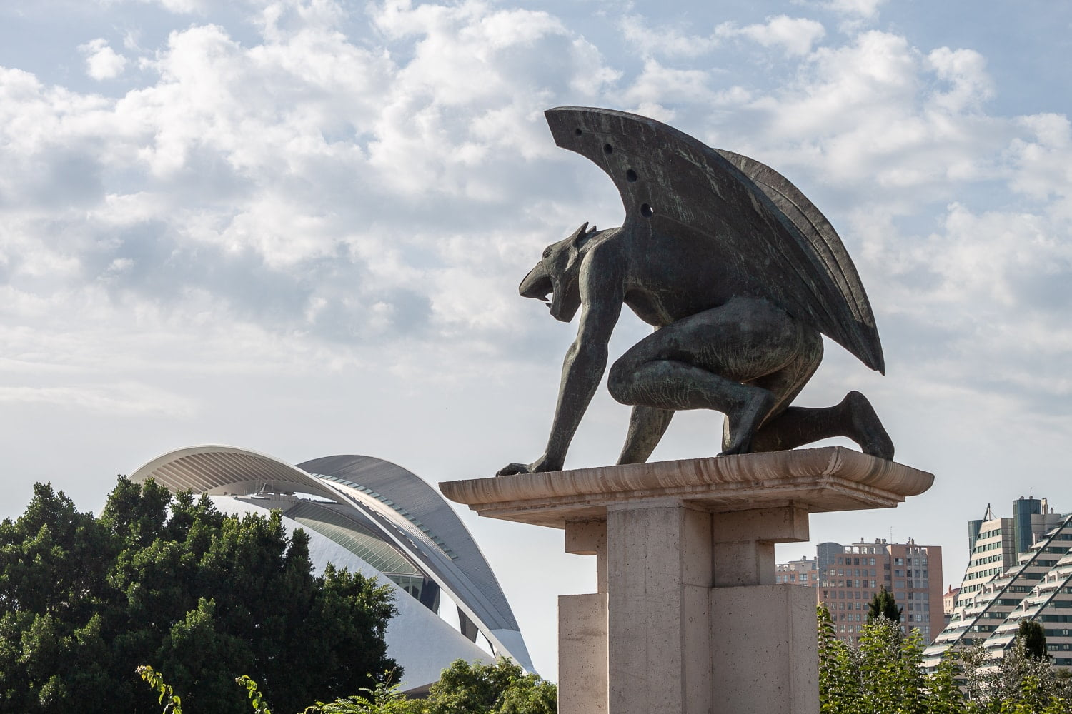 Gargoyle in Valencia looking at the City of Arts and Sciences.