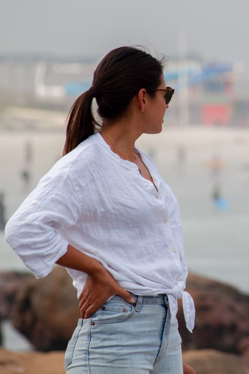 Kim wearing her white linen shirt ready for anything in Muizenberg, Cape Town.