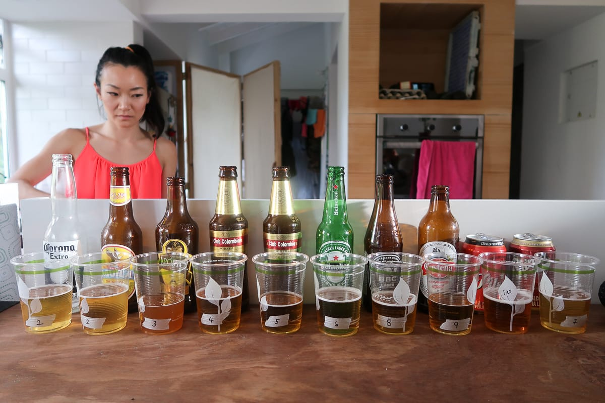 Alice behind the line up of beers for our beer tast test in Medellin