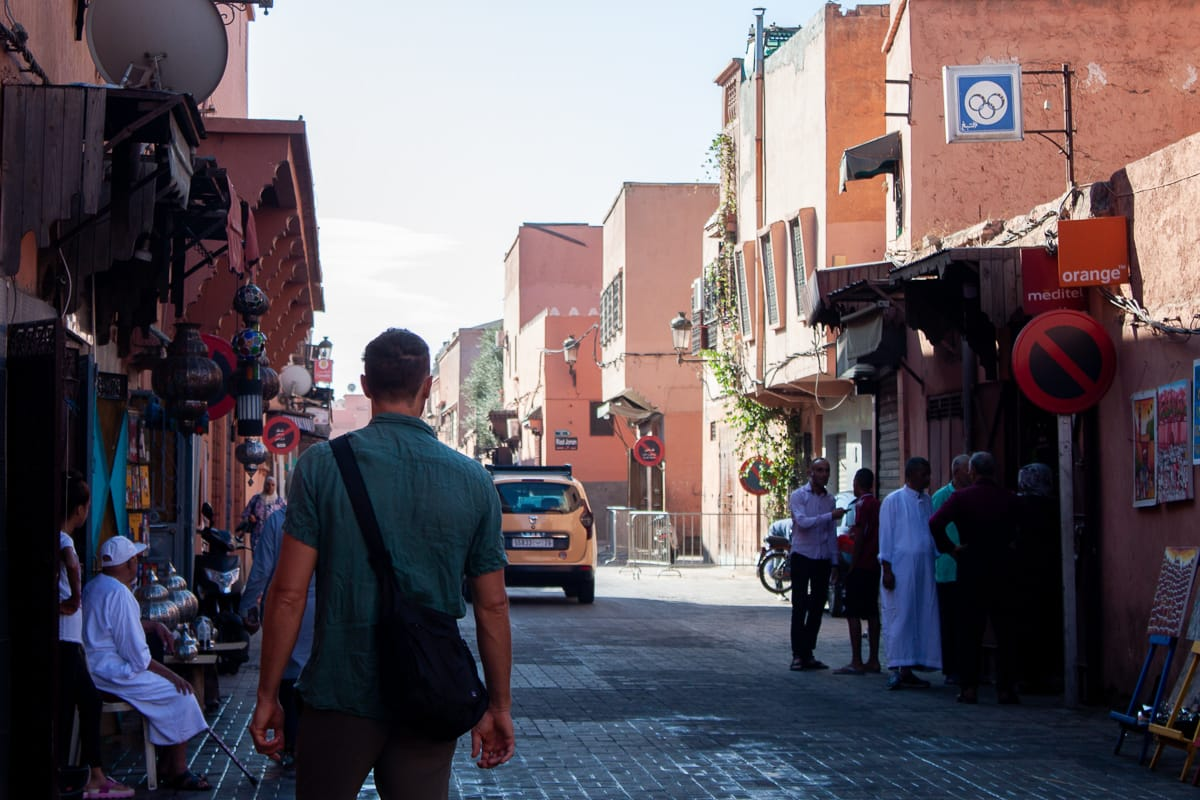 Chris walking the early morning streets of Marrakech in search of a sim card.