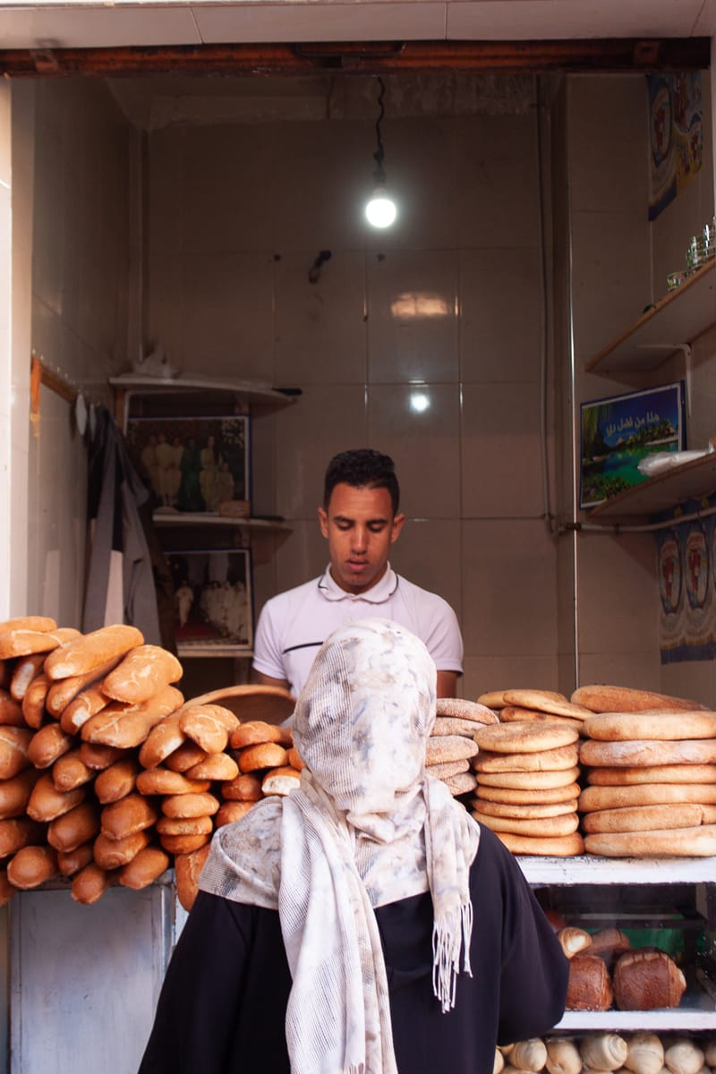 Lady buying bread in the streets of Marrakech