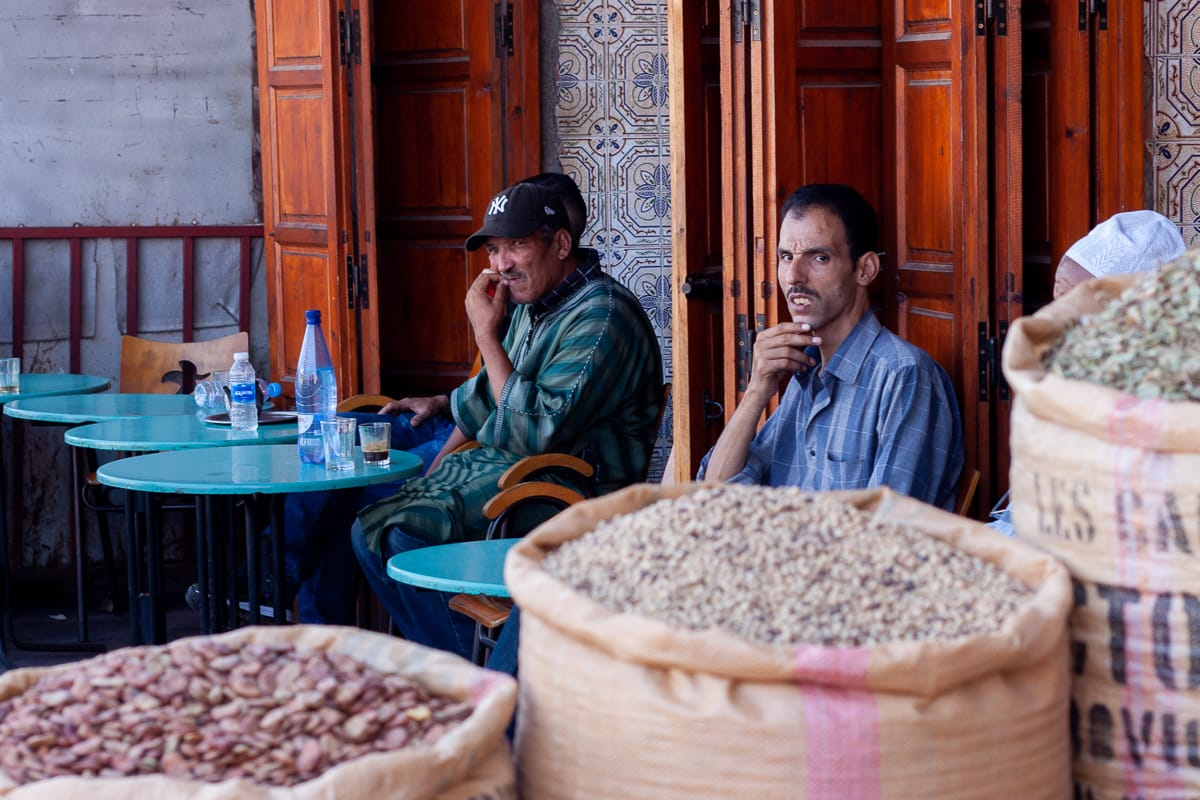 Moroccan men drinking coffee and tea in Marrakech.