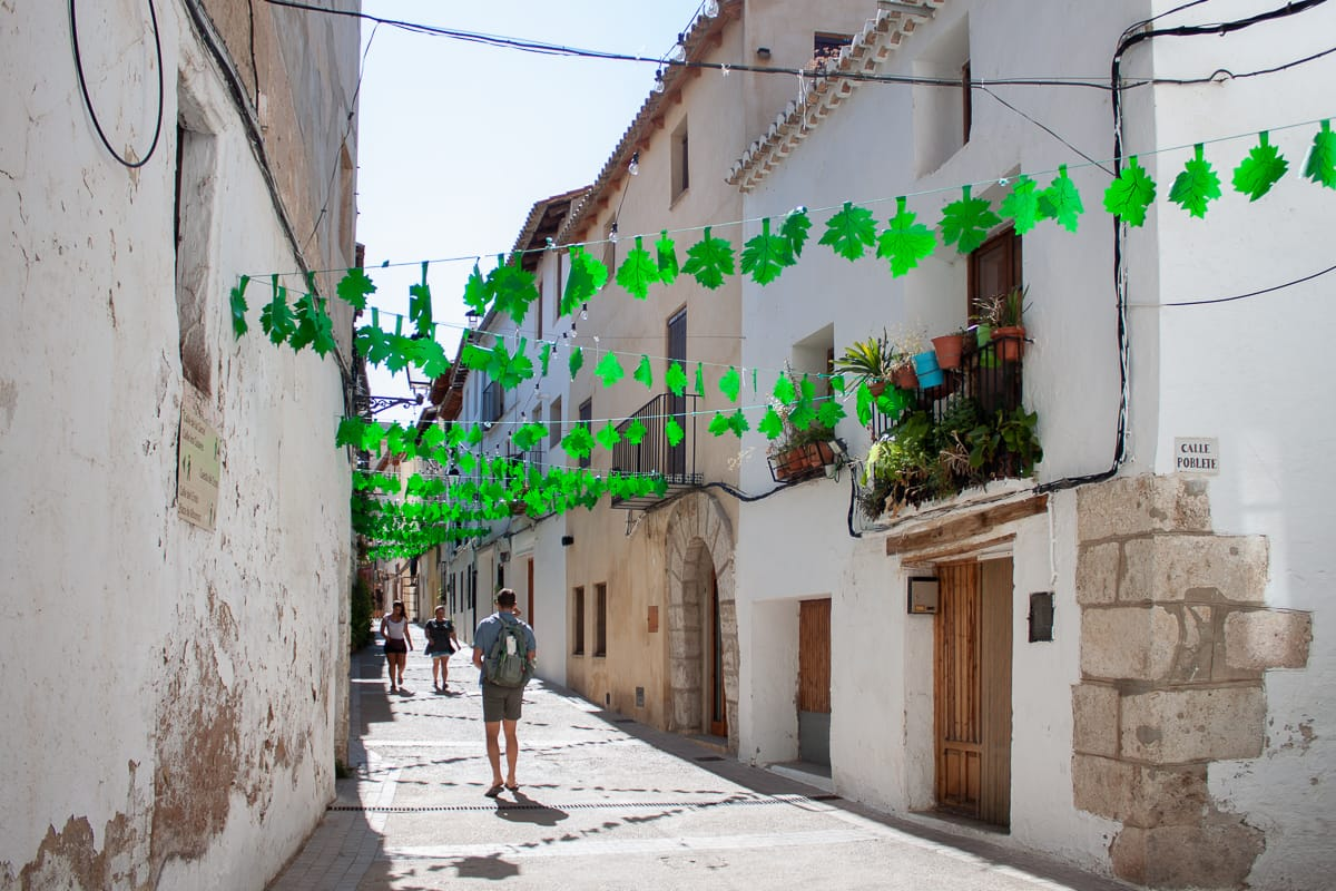 Chris walks down street during the wine festival in Requena