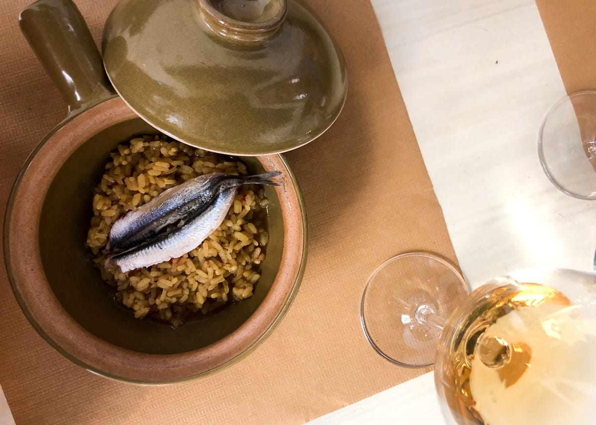 Valencia food and drink cover photo - seafood rice and natural wine