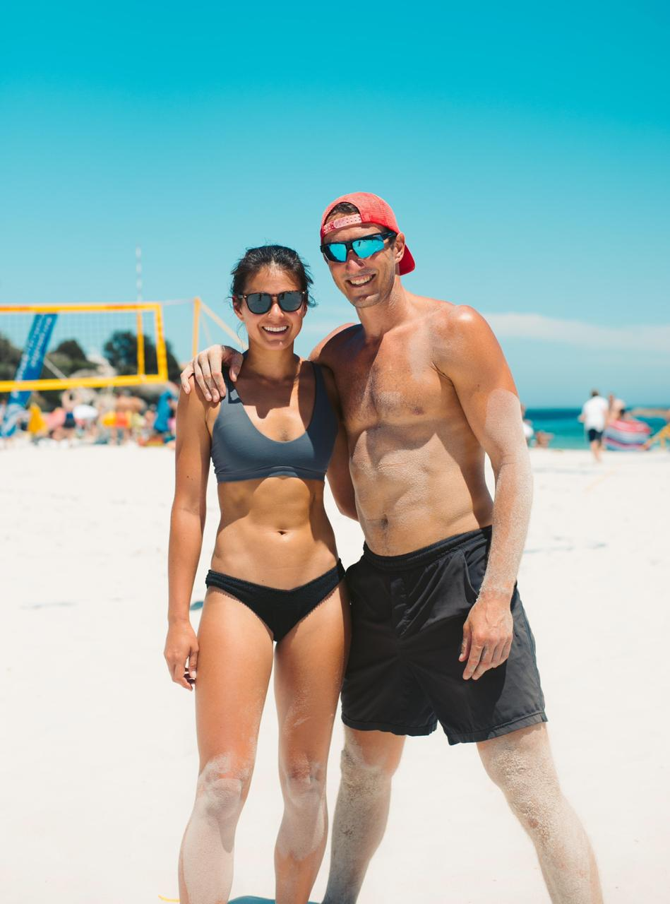 Kim and Chris playing beach volleyball