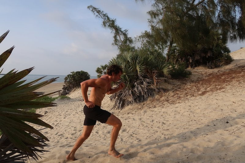 Chris running up the dunes for an outdoor workout in Lamu, Kenya.