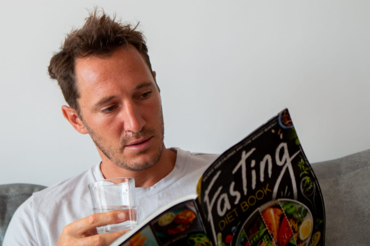 Chris reading a fasting book, which is surprisingly unnecessary for a fast.