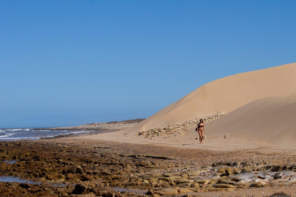 Kim taking a long walk on the beach in Essaouira in Morocco