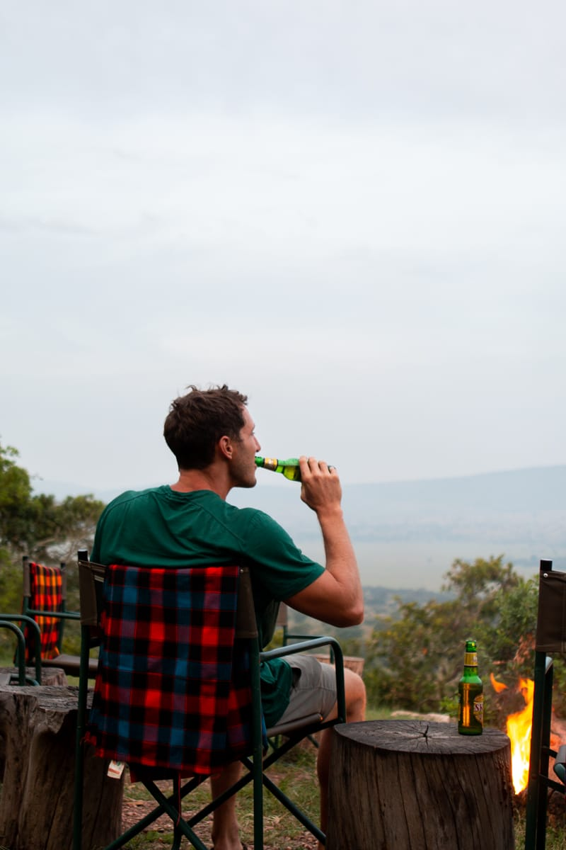 Chris takes a sip of beer in Akagera National Park in Rwanda