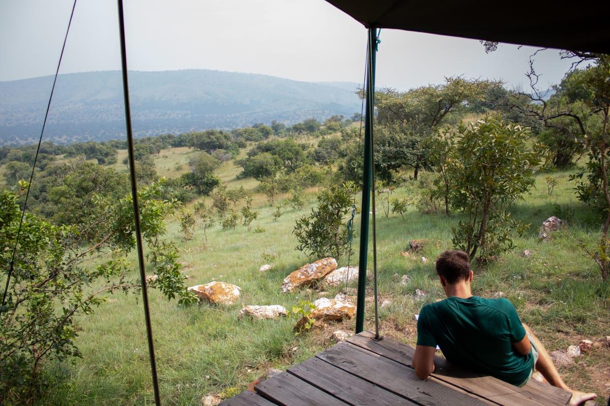 Chris reading at Karenge Bush Camp